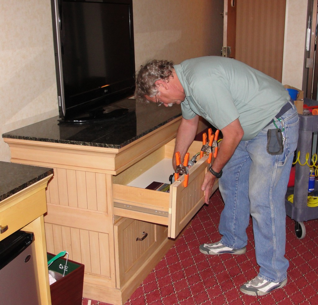 Here one of our experienced professional is doing the final touches to a new drawer instillation.